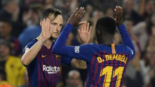 Barcelona's Croatian midfielder Ivan Rakitic (L) celebrates with Barcelona's French forward Ousmane Dembele after scoring during the Spanish league football match FC Barcelona against Sevilla FC at the Camp Nou stadium in Barcelona on October 20, 2018. (Photo by LLUIS GENE / AFP)