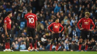Manchester United's English midfielder Jesse Lingard (L), Manchester United's English striker Marcus Rashford (2L), Manchester United's English defender Chris Smalling and Manchester United's Belgian midfielder Marouane Fellaini react after City scored their second goal during the English Premier League football match between Manchester City and Manchester United at the Etihad Stadium in Manchester, north west England, on November 11, 2018. (Photo by Oli SCARFF / AFP) / RESTRICTED TO EDITORIAL USE. No use with unauthorized audio, video, data, fixture lists, club/league logos or 'live' services. Online in-match use limited to 120 images. An additional 40 images may be used in extra time. No video emulation. Social media in-match use limited to 120 images. An additional 40 images may be used in extra time. No use in betting publications, games or single club/league/player publications. /