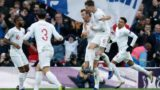 England players (L-R) England's midfielder Raheem Sterling, England's defender Ben Chilwell, England's striker Harry Kane and England's defender John Stones celebrate after England's midfielder Jesse Lingard (R) scores their first goal during the international UEFA Nations League football match between England and Croatia at Wembley Stadium in London on November 18, 2018. (Photo by Adrian DENNIS / AFP) / NOT FOR MARKETING OR ADVERTISING USE / RESTRICTED TO EDITORIAL USE