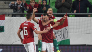 Hungary's forward Adam Szalai (C) celebrates scoring with midfielder Balazs Dzsudzsak and defender Willi Orban (L) during the UEFA Nations League football match Hungary v Finland in Budapest on November 18, 2018. (Photo by ATTILA KISBENEDEK / AFP)