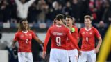(From L) Switzerland's defender Kevin Mbabu, team mates forward Haris Seferovic, midfielder Granit Xhaka and defender Nico Elvedi reacts after Seferovic scores his team's third goal during the UEFA Nations League, league A, group 2 football match between Switzerland and Belgium at the Swissporarena stadium in Lucerne, on November 18, 2018. (Photo by Fabrice COFFRINI / AFP)