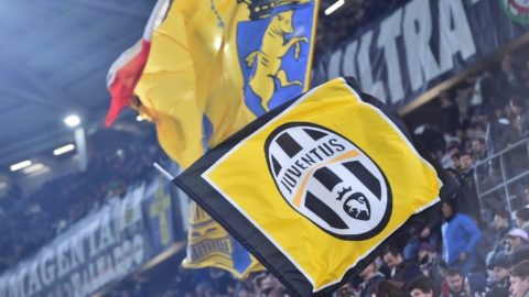 Juventus fans wave flags before the UEFA Champions League football match Juventus vs Olympique Lyonnais on November 2, 2016 at the Juventus stadium in Turin. (Photo by GIUSEPPE CACACE / AFP)