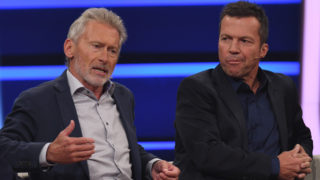 """Former soccer players Paul Breitner (L) and Lothar Matthaus (R) perform during the recording of the ZDF television show """"Wir lieben Fernsehen"""" (We love Television) in Cologne, Germany, 13 July 2017. Photo: Henning Kaiser/dpa"""