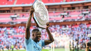 Manchester City Defender Benjamin Mendy (22) lifts the Community Shield as they beat Chelsea at the FA Community Shield match between Chelsea and Manchester City at Wembley Stadium, London, England on August 5, 2018, photo Stephen Wright / ProSportsImages / DPPI