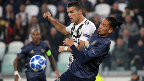 Cristiano Ronaldo #7 of Juventus FC competes for the ball with Chris Smalling #12 of Manchester United during  the UEFA Champions League group H match between Juventus FC and Manchester United at Allianz Stadium on November 07, 2018 in Turin, Italy. (Photo by Giuseppe Cottini/NurPhoto)