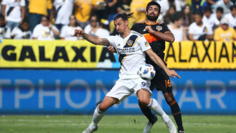 CARSON, CA - OCTOBER 28: Zlatan Ibrahimovic #9 of Los Angeles Galaxy and Kevin Garcia #16 of Houston Dynamo vie for the ball during the second half of their MLS match at StubHub Center on October 28, 2018 in Carson, California. The Dynamo defeated the Galaxy 3-2. (Photo by Victor Decolongon/Getty Images)