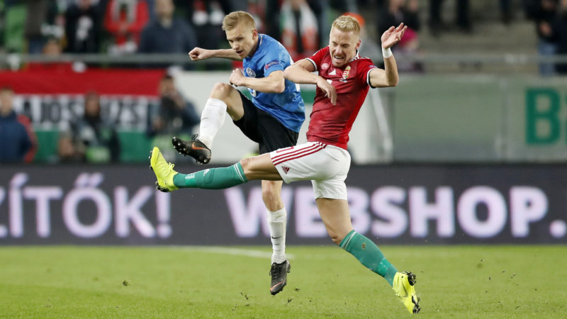 BUDAPEST, HUNGARY - NOVEMBER 15: (l-r) Taijo Teniste of Estonia competes for the ball with Balazs Dzsudzsak of Hungary during the UEFA Nations League group stage match between Hungary and Estonia at Groupama Arena on November 15, 2018 in Budapest, Hungary. (Photo by Laszlo Szirtesi/Getty Images)