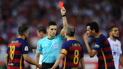 MADRID, SPAIN - MAY 22:  Barcelona players protest while Referee Carlos del Cerro Grande hands Javier Mascherano of FC Barcelona the red card for during the Copa del Rey Final between Barcelona and Sevilla at Vicente Calderon Stadium    on May 22, 2016 in Madrid, Spain.  (Photo by Denis Doyle/Getty Images)
