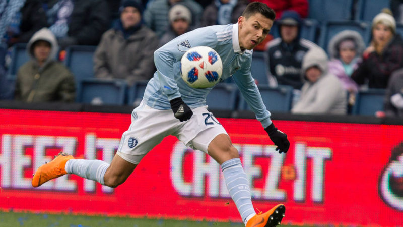 KANSAS CITY, KS - APRIL 15: Daniel Salloi #20 of Sporting Kansas City attempt to control the ball in the Seattle Sounders backfield during the second half on April 15, 2018 at Children's Mercy Park in Kansas City, Kansas. (Photo by Kyle Rivas/Getty Images)