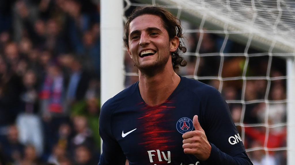 Paris Saint-Germain's French midfielder Adrien Rabiot celebrates after scoring his team's second goal during the French L1 football match between Paris Saint-Germain (PSG) and Amiens at the Parc des Princes stadium in Paris on October 20, 2018. (Photo by Anne-Christine POUJOULAT / AFP)