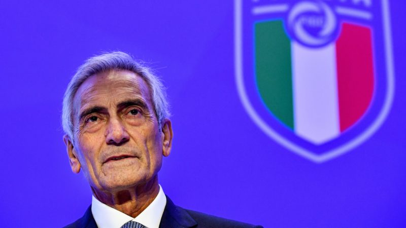 New President of the Italian Football Federation (FIGC), Gabriele Gravina poses with the federation's logo following the vote during the elective assembly of the FIGC on October 22, 2018 at the Hilton hotel of Rome's Fiumicino airport. (Photo by Alberto PIZZOLI / AFP)
