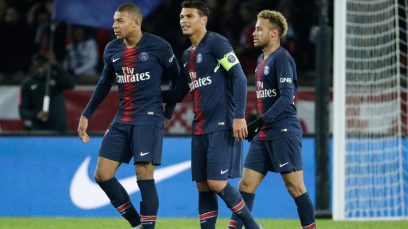 (From L) Paris Saint-Germain's French forward Kylian Mbappe, Paris Saint-Germain's Brazilian defender Thiago Silva and Paris Saint-Germain's Brazilian forward Neymar celebrate after winning at the end of the French L1 football match between Paris Saint-Germain (PSG) and Lille (LOSC) at the Parc des Princes stadium, in Paris, November 2, 2018. (Photo by Geoffroy VAN DER HASSELT / AFP)