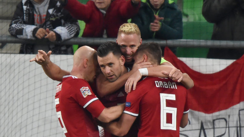 Hungary's forward Adam Szalai (C) celebrates scoring with his teammates during the UEFA Nations League football match Hungary v Finland in Budapest on November 18, 2018. (Photo by ATTILA KISBENEDEK / AFP)