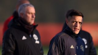 Manchester United's Portuguese manager Jose Mourinho (L) and Manchester United's Chilean striker Alexis Sanchez attend a training session at the Carrington Training complex in Manchester, north west England on November 26, 2018, on the eve of their UEFA Champions League group H football match against Young Boys. (Photo by Oli SCARFF / AFP)