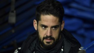 Real Madrid's Spanish midfielder Isco arrives to sit on the bench during the Spanish league football match between Real Madrid and Valencia at the Santiago Bernabeu stadium in Madrid on December 1, 2018. (Photo by OSCAR DEL POZO / AFP)