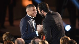 Paris Saint-Germain's French forward Kylian Mbappe (L) is congratulated by Paris Saint-Germain's Italian goalkeeper Gianluigi Buffon after receiving the Kopa Trophy during the 2018  Ballon d'Or award ceremony at the Grand Palais in Paris on December 3, 2018. (Photo by FRANCK FIFE / AFP)
