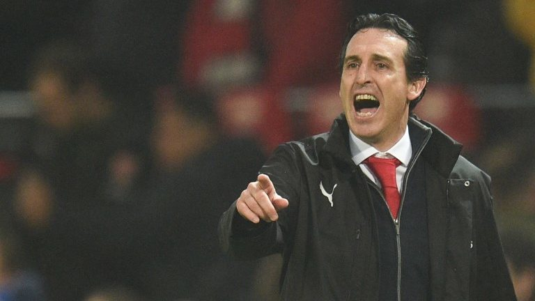 Arsenal's Spanish head coach Unai Emery gestures on the touchline during the English Premier League football match between Manchester United and Arsenal at Old Trafford in Manchester, north west England, on December 5, 2018. (Photo by Oli SCARFF / AFP) / RESTRICTED TO EDITORIAL USE. No use with unauthorized audio, video, data, fixture lists, club/league logos or 'live' services. Online in-match use limited to 120 images. An additional 40 images may be used in extra time. No video emulation. Social media in-match use limited to 120 images. An additional 40 images may be used in extra time. No use in betting publications, games or single club/league/player publications. /