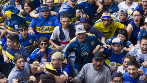 Fans of Boca Juniors in Buenos Aires' La Boca neighbourhood react as they watch the second leg match of the all-Argentine Copa Libertadores final between Boca Juniors and River Plate being played at the Santiago Bernabeu stadium in Madrid on December 9, 2018. - The second leg is held at the home of Real Madrid following the controversial decision of South America's football federation, CONMEBOL, to take the fixture out of Argentina following an attack by River Plate fans on the Boca Juniors team bus. (Photo by ALBERTO RAGGIO / AFP)