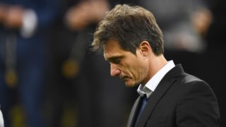 Boca Juniors' coach Guillermo Barros Schelotto is seen after losing 3-1 to River Plate in the second leg match of the all-Argentine Copa Libertadores final, at the Santiago Bernabeu stadium in Madrid, on December 9, 2018. - River Plate came from behind to beat bitter Argentine rivals Boca Juniors 3-1 after extra time (Photo by Gabriel BOUYS / AFP)