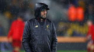 Liverpool's German manager Jurgen Klopp checks out the conditions before the English Premier League football match between Wolverhampton Wanderers and Liverpool at the Molineux stadium in Wolverhampton, central England  on December 21, 2018. (Photo by Geoff CADDICK / AFP) / RESTRICTED TO EDITORIAL USE. No use with unauthorized audio, video, data, fixture lists, club/league logos or 'live' services. Online in-match use limited to 120 images. An additional 40 images may be used in extra time. No video emulation. Social media in-match use limited to 120 images. An additional 40 images may be used in extra time. No use in betting publications, games or single club/league/player publications. /