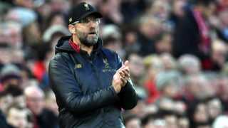 Liverpool's German manager Jurgen Klopp gestures on the touchline during the English Premier League football match between Liverpool and Newcastle United at Anfield in Liverpool, north west England on December 26, 2018. (Photo by Paul ELLIS / AFP) / RESTRICTED TO EDITORIAL USE. No use with unauthorized audio, video, data, fixture lists, club/league logos or 'live' services. Online in-match use limited to 120 images. An additional 40 images may be used in extra time. No video emulation. Social media in-match use limited to 120 images. An additional 40 images may be used in extra time. No use in betting publications, games or single club/league/player publications. /
