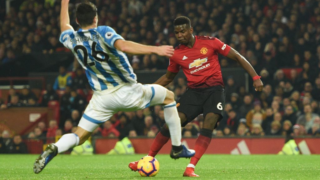 Manchester United's French midfielder Paul Pogba scores their second goal during the English Premier League football match between Manchester United and Huddersfield Town at Old Trafford in Manchester, north west England, on December 26, 2018. (Photo by Oli SCARFF / AFP) / RESTRICTED TO EDITORIAL USE. No use with unauthorized audio, video, data, fixture lists, club/league logos or 'live' services. Online in-match use limited to 120 images. An additional 40 images may be used in extra time. No video emulation. Social media in-match use limited to 120 images. An additional 40 images may be used in extra time. No use in betting publications, games or single club/league/player publications. /