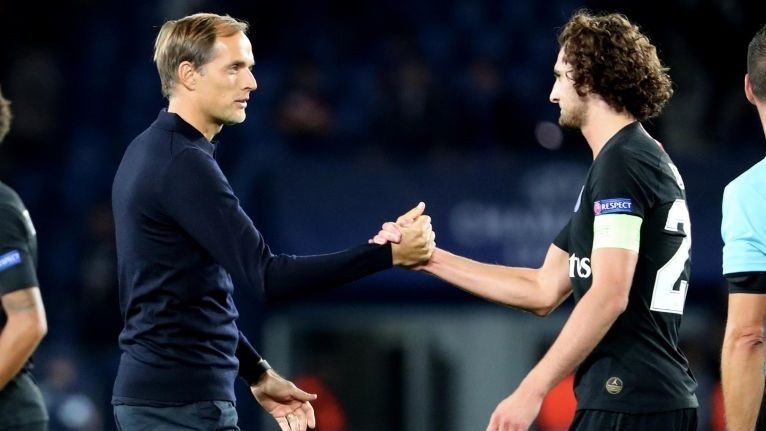 PARIS, FRANCE - OCTOBER 03:  Adrien Rabiot of Paris Saint-Germain celebrates with head coach Thomas Tuchel after the Group C match of the UEFA Champions League between Paris Saint-Germain and Red Star Belgrade at Parc des Princes on October 3, 2018 in Paris, France.  (Photo by Xavier Laine/Getty Images)