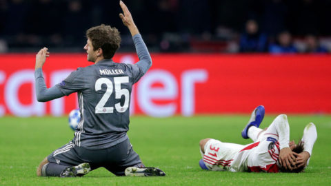 AMSTERDAM, NETHERLANDS - DECEMBER 12: (L-R) Thomas Muller of Bayern Munchen, Nicolas Tagliafico of Ajax  during the UEFA Champions League  match between Ajax v Bayern Munchen at the Johan Cruijff Arena on December 12, 2018 in Amsterdam Netherlands (Photo by Erwin Spek/Soccrates/Getty Images)