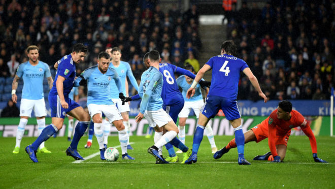 LEICESTER, ENGLAND - DECEMBER 18:  Nicolas Otamendi of Manchester City is challenged by Harry Maguire of Leicester City inside of the penalty area during the Carabao Cup Quarter Final match between Leicester City and Manchester United at The King Power Stadium on December 18, 2018 in Leicester, United Kingdom.  (Photo by Shaun Botterill/Getty Images)