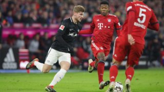 MUNICH, GERMANY - DECEMBER 19:  Timo Werner (L) of Leipzig battles for the ball with David Alaba of Bayern Muenchen during the Bundesliga match between FC Bayern Muenchen and RB Leipzig at Allianz Arena on December 19, 2018 in Munich, Germany.  (Photo by Alexander Hassenstein/Bongarts/Getty Images)
