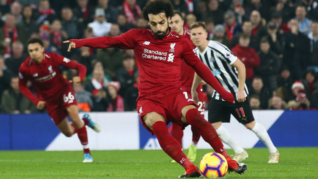 LIVERPOOL, ENGLAND - DECEMBER 26:  Mohamed Salah of Liverpool scores his team's second goal from a penalty during the Premier League match between Liverpool FC and Newcastle United at Anfield on December 26, 2018 in Liverpool, United Kingdom.  (Photo by Jan Kruger/Getty Images)
