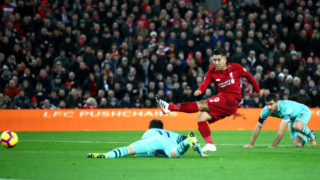 LIVERPOOL, ENGLAND - DECEMBER 29:  Roberto Firmino of Liverpool scores his sides second goal during the Premier League match between Liverpool FC and Arsenal FC at Anfield on December 29, 2018 in Liverpool, United Kingdom.  (Photo by Clive Brunskill/Getty Images)