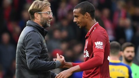 Liverpool's German manager Jurgen Klopp (L) greets Liverpool's German-born Cameroonian defender Joel Matip after the English Premier League football match between Liverpool and Southampton at Anfield in Liverpool, north west England on September 22, 2018. (Photo by Paul ELLIS / AFP) / RESTRICTED TO EDITORIAL USE. No use with unauthorized audio, video, data, fixture lists, club/league logos or 'live' services. Online in-match use limited to 120 images. An additional 40 images may be used in extra time. No video emulation. Social media in-match use limited to 120 images. An additional 40 images may be used in extra time. No use in betting publications, games or single club/league/player publications. /