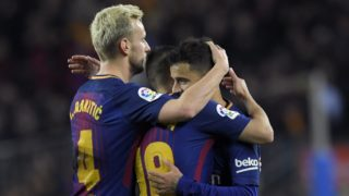 Barcelona's Brazilian midfielder Philippe Coutinho (R) celebrates with Barcelona's Spanish defender Jordi Alba (C) and Barcelona's Croatian midfielder Ivan Rakitic (L) after scoring during the Spanish league football match between FC Barcelona and Girona FC at the Camp Nou stadium in Barcelona on February 24, 2018. (Photo by LLUIS GENE / AFP)