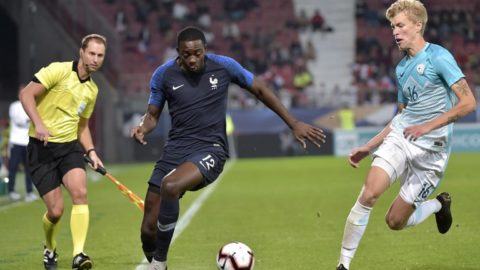 French forward Jean-Philippe Mateta (L) vies with Slovenian defender Ziga Lipuscek (R) during the match between France and Slovenia European Under-21 Championship 2019 Qualifying Round football match at the Gaston Gerard stadium in Lyon, central eastern France on October 16, 2018. (Photo by ROMAIN LAFABREGUE / AFP)