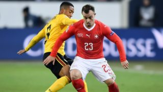 Switzerland's midfielder Xherdan Shaqiri (R) and Belgium's midfielder Youri Tielemans vie for the ball during the UEFA Nations League, league A, group 2 football match between Switzerland and Belgium at the Swissporarena stadium in Lucerne, on November 18, 2018. (Photo by Fabrice COFFRINI / AFP)