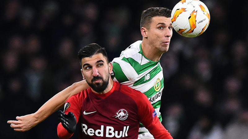 Salzburg's Israeli striker Moanes Dabour (L) vies with Celtic's Croatian-born Bosnian defender Jozo Simunovic during the UEFA Europa League group B football match between Celtic and Salzburg at Celtic Park stadium in Glasgow, Scotland on December 13, 2018. (Photo by ANDY BUCHANAN / AFP)