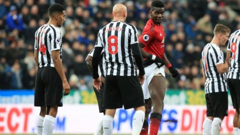 Manchester United's French midfielder Paul Pogba (C) shows his leg to Newcastle United's English midfielder Jonjo Shelvey (2l) following a cahllenge from Newcastle United's Enlish midfielder Isaac Hayden (L) during the English Premier League football match between Newcastle United and Manchester United at St James' Park in Newcastle-upon-Tyne, north east England on January 2, 2019. (Photo by Lindsey PARNABY / AFP) / RESTRICTED TO EDITORIAL USE. No use with unauthorized audio, video, data, fixture lists, club/league logos or 'live' services. Online in-match use limited to 120 images. An additional 40 images may be used in extra time. No video emulation. Social media in-match use limited to 120 images. An additional 40 images may be used in extra time. No use in betting publications, games or single club/league/player publications. /