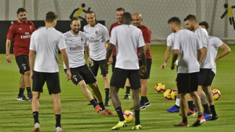 AC Milan's Italian coach Gennaro Gattuso (L) watches as AC Milan's Argentine forward Gonzalo Higuain (3rd L), AC Milan's Uruguayan midfielder Diego Laxalt (behind) and teammates take part in training at the King Abdullah Sports City Stadium in Jeddah on January 15, 2019, a day before the Supercoppa Italiana final against Juventus. (Photo by Fayez Nureldine / AFP)