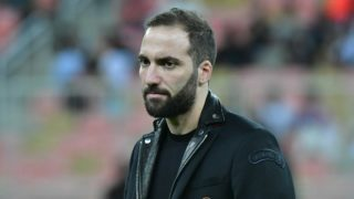 AC Milan's Argentine forward Gonzalo Higuain is seen on the pitch ahead of Supercoppa Italiana final between Juventus and AC Milan at the King Abdullah Sports City Stadium in Jeddah on January 16, 2019. (Photo by GIUSEPPE CACACE / AFP)
