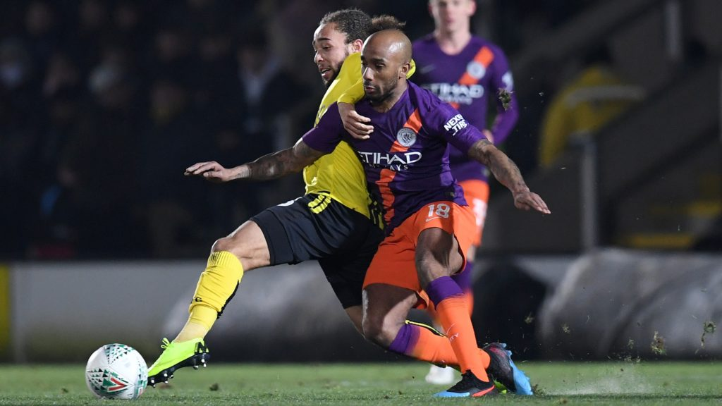 Burton Albion's English midfielder Marcus Harness (L) vies with Manchester City's English midfielder Fabian Delph during the English League Cup second leg semi-final football match between Burton Albion and Manchester City at the Pirelli Stadium in Burton-upon-Trent, central England on January 23, 2019. (Photo by Paul ELLIS / AFP) / RESTRICTED TO EDITORIAL USE. No use with unauthorized audio, video, data, fixture lists, club/league logos or 'live' services. Online in-match use limited to 120 images. An additional 40 images may be used in extra time. No video emulation. Social media in-match use limited to 120 images. An additional 40 images may be used in extra time. No use in betting publications, games or single club/league/player publications. /