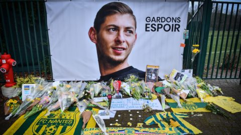 A picture shows flowers put in front of the entrance of the training center La Joneliere in La Chapelle-sur-Erdre on January 25, 2019, four days after the plane of Argentinian forward Emiliano Sala vanished during a flight from Nantes, western France, to Cardiff in Wales. - The 28-year-old Argentine striker is one of two people still missing after contact was lost with the light aircraft he was travelling in on January 21, 2019 night. Sala was on his way to the Welsh capital to train with his new teammates for the first time after completing a£15 million ($19 million) move to Cardiff City from French side Nantes on January 19. (Photo by LOIC VENANCE / AFP)