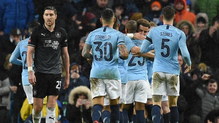 Manchester City players celebrate after Manchester City's Portuguese midfielder Bernardo Silva scored their second goal during the English FA Cup fourth round football match between Manchester City and Burnley at the Etihad Stadium in Manchester, north west England, on January 26, 2019. (Photo by Oli SCARFF / AFP) / RESTRICTED TO EDITORIAL USE. No use with unauthorized audio, video, data, fixture lists, club/league logos or 'live' services. Online in-match use limited to 120 images. An additional 40 images may be used in extra time. No video emulation. Social media in-match use limited to 120 images. An additional 40 images may be used in extra time. No use in betting publications, games or single club/league/player publications. /