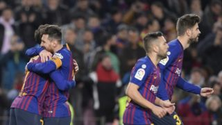 Barcelona's Brazilian midfielder Philippe Coutinho (L) celebrates with Barcelona's Argentinian forward Lionel Messi after scoring during the Spanish Copa del Rey (King's Cup) quarter-final second leg football match between Barcelona and Sevilla at the Camp Nou stadium in Barcelona on January 30, 2019. (Photo by LLUIS GENE / AFP)