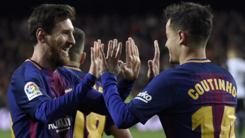 Barcelona's Brazilian midfielder Philippe Coutinho (R) celebrates a goal with Barcelona's Argentinian forward Lionel Messi during the Spanish 'Copa del Rey' (King's cup) second leg semi-final football match between Valencia CF and FC Barcelona at the Mestalla stadium in Valencia on February 8, 2018. (Photo by JOSE JORDAN / AFP)