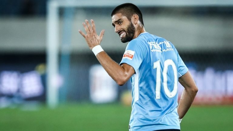 Belgian football player Yannick Ferreira Carrasco of Dalian Yifang reacts as he competes against Guangzhou R&F in their 17th round match during the 2018 Chinese Football Association Super League (CSL) in Dalian city, northeast China's Liaoning province, 10 August 2018.   Dalian Yifang defeated Guangzhou R&F 3-0.