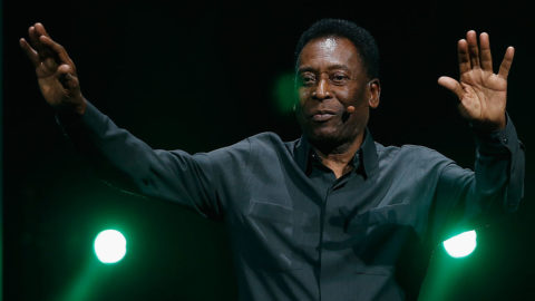LOS ANGELES, CA - JUNE 15:  Retired Brazilian professional footballer Pele waves to fans as he leaves the Electronic Arts E3 press conference at the LA Sports Arena on June 15, 2015 in Los Angeles, California. The EA press conference is held in conjunction with the annual Electronic Entertainment Expo (E3) which focuses on gaming systems and interactive entertainment, featuring introductions to new products and technologies.  (Photo by Christian Petersen/Getty Images)