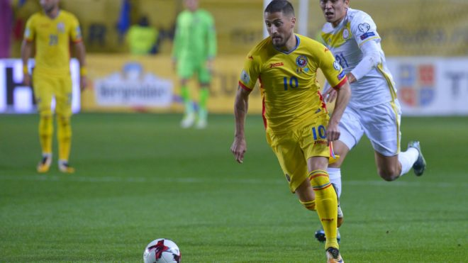 Romanian's Gheorghe Grozav runs with the ball during the FIFA World Cup 2018 group E qualification match between Romania and Kazakhstan in Ploiesti, southern Romania on October 5, 2017. (Photo by Stringer / AFP)