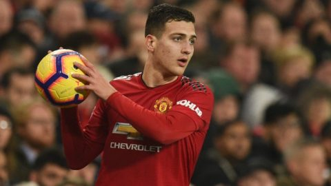 Manchester United's Portuguese defender Diogo Dalot prepares to take a throw in during the English Premier League football match between Manchester United and Arsenal at Old Trafford in Manchester, north west England, on December 5, 2018. (Photo by Oli SCARFF / AFP) / RESTRICTED TO EDITORIAL USE. No use with unauthorized audio, video, data, fixture lists, club/league logos or 'live' services. Online in-match use limited to 120 images. An additional 40 images may be used in extra time. No video emulation. Social media in-match use limited to 120 images. An additional 40 images may be used in extra time. No use in betting publications, games or single club/league/player publications. /