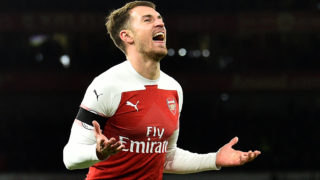 Arsenal's Welsh midfielder Aaron Ramsey celebrates scoring his team's third goal during the English Premier League football match between Arsenal and Fulham at the Emirates Stadium in London on January 1, 2019. (Photo by Glyn KIRK / AFP) / RESTRICTED TO EDITORIAL USE. No use with unauthorized audio, video, data, fixture lists, club/league logos or 'live' services. Online in-match use limited to 120 images. An additional 40 images may be used in extra time. No video emulation. Social media in-match use limited to 120 images. An additional 40 images may be used in extra time. No use in betting publications, games or single club/league/player publications. /